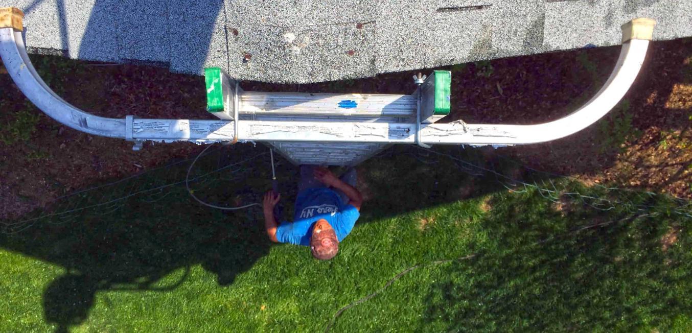 73501-employee-climbing-ladder-roof