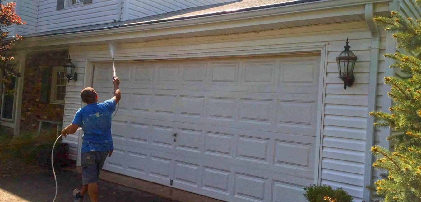 73502-employee-power-washing-garage-door